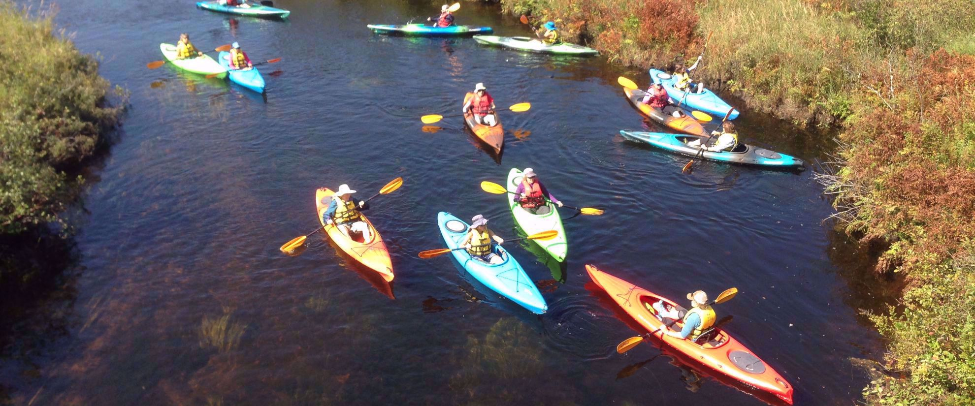 Women's travel group kayaking in Adirondacks