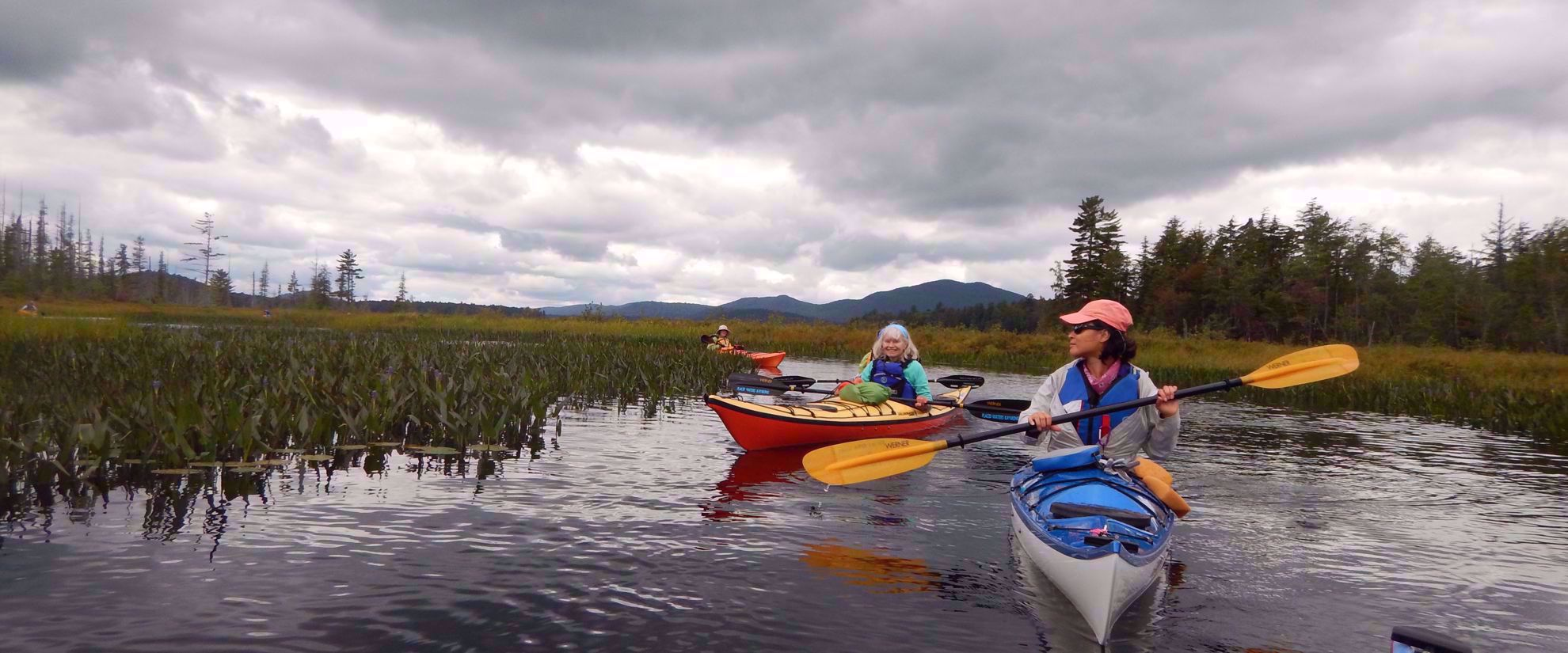 women's tour group kayaking in the adirondacks