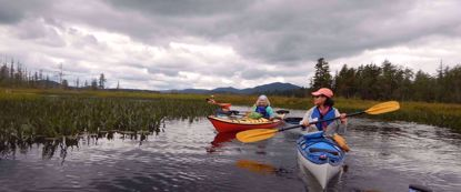 women's tour group kayaking in the adirondacks