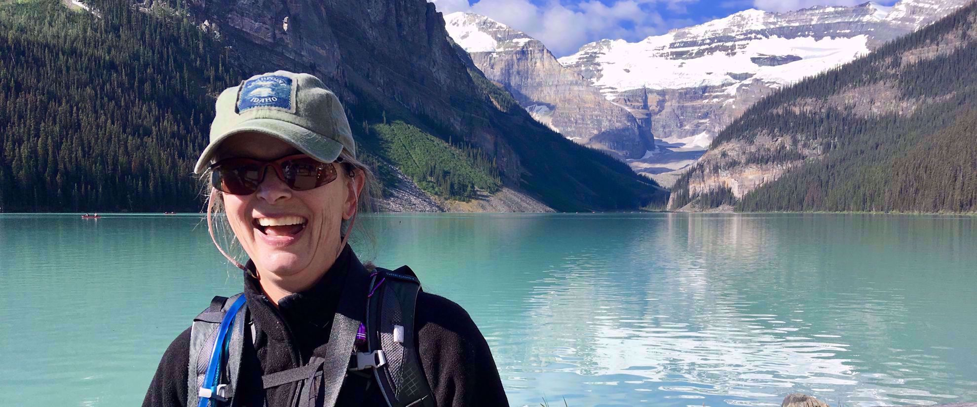 Woman smiling on group tour through canadian rockies