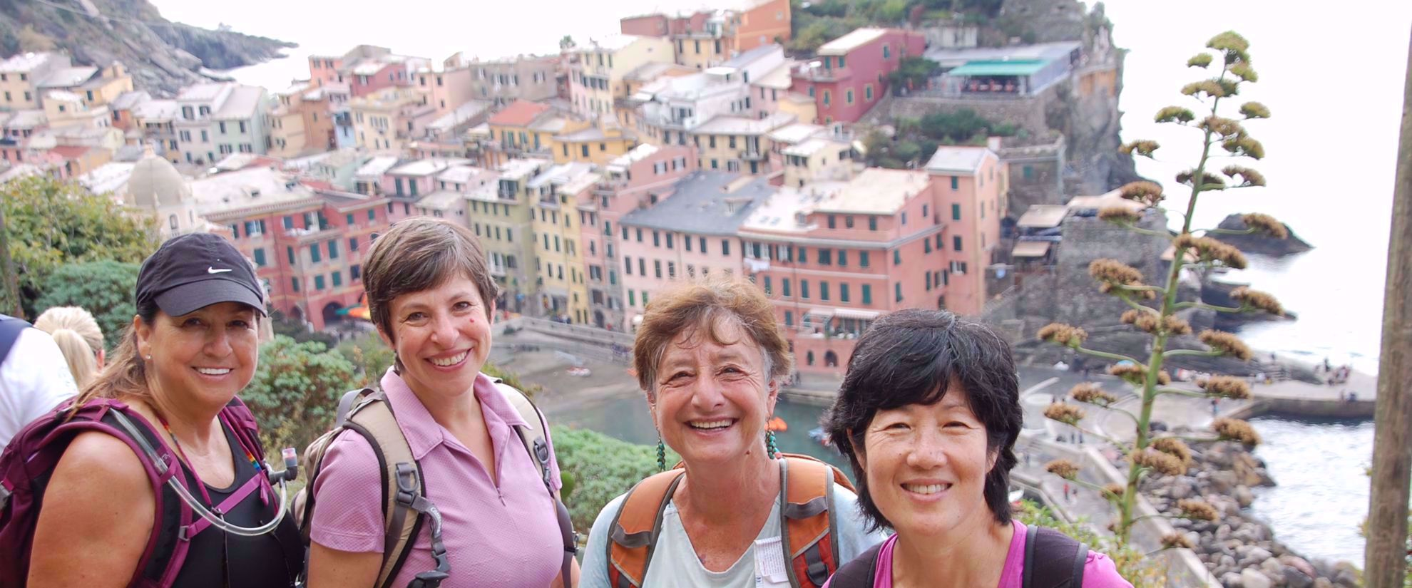 women smiling on group trip to cinque terre and the italian riviera