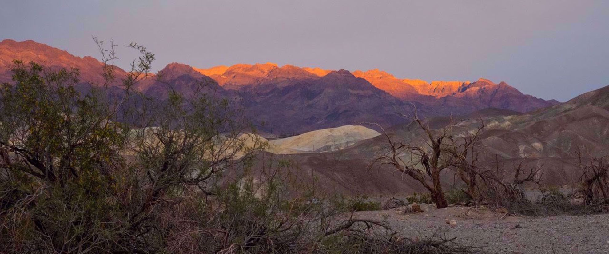 red sunset on mountain tops of death valley