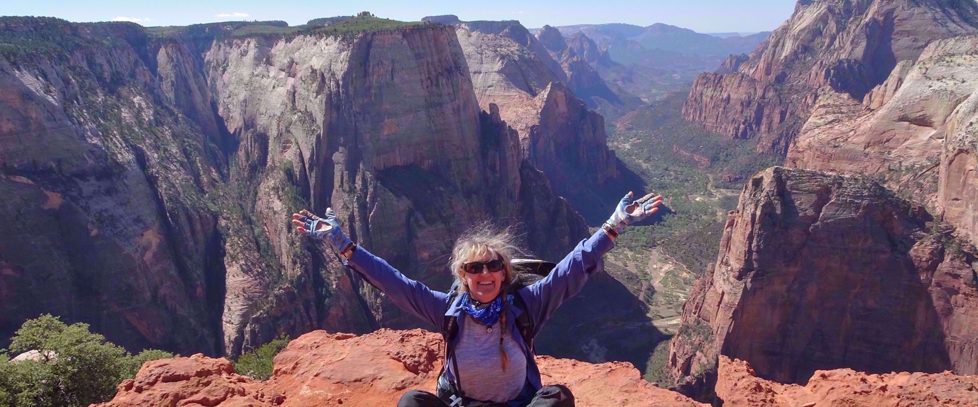 woman smiles after finishing hike in bryce national park
