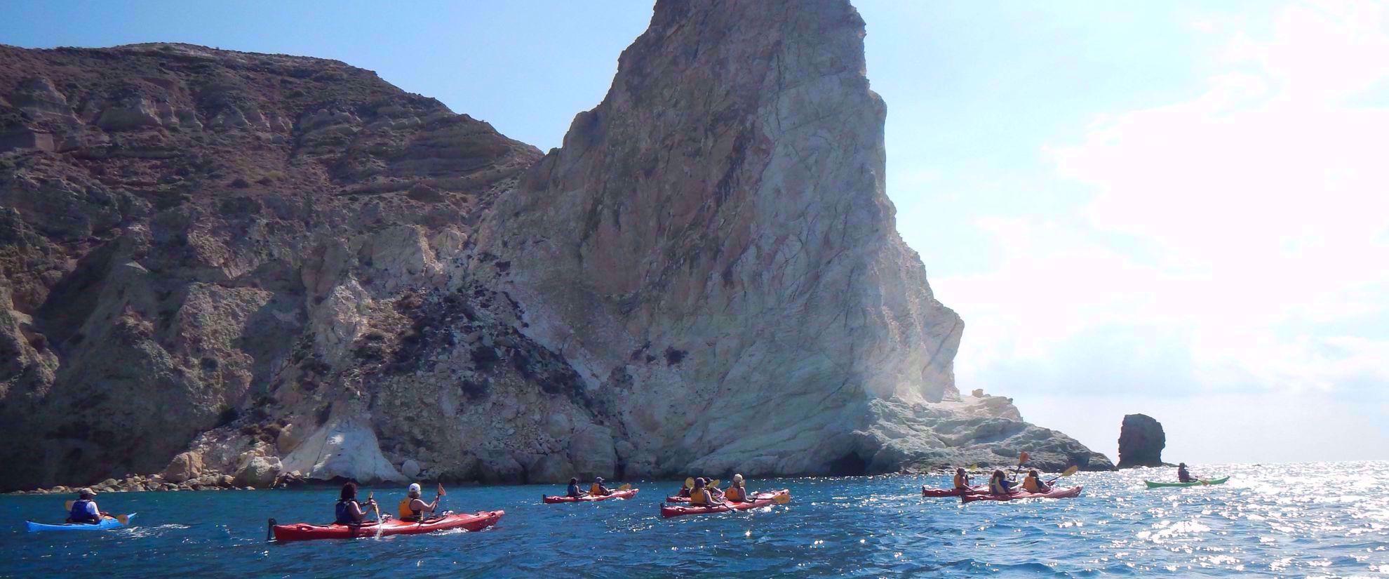women's tour group kayaking through greek islands