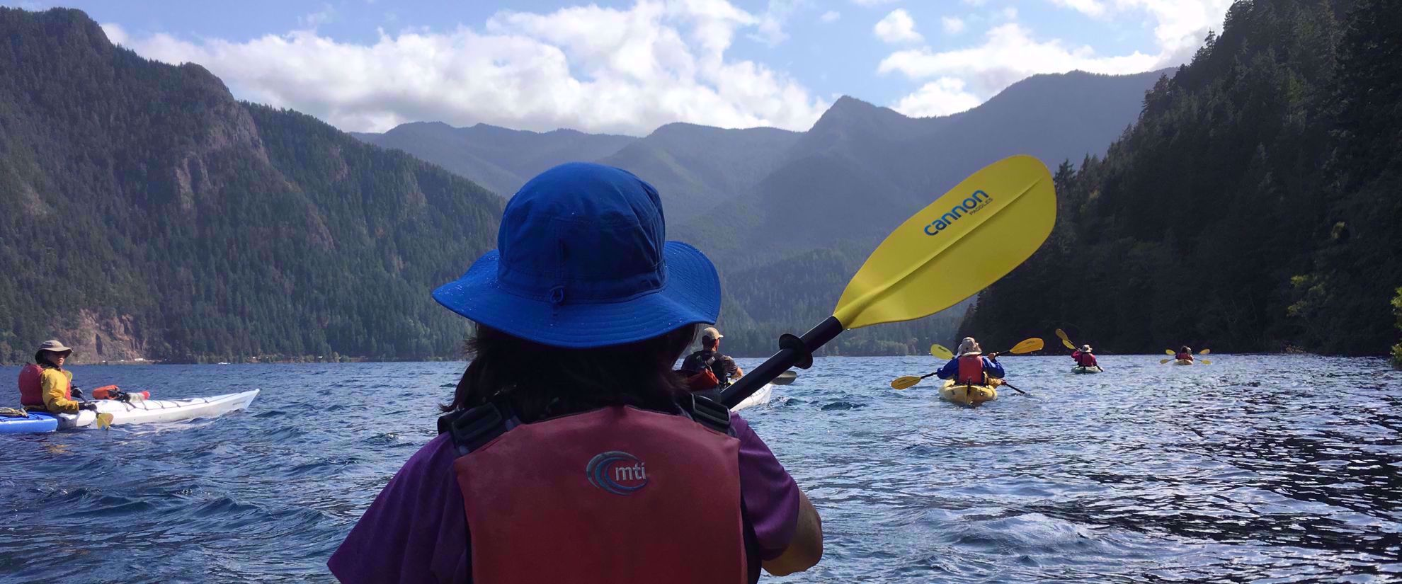 women's adventure travel group kayaking through olympic national park