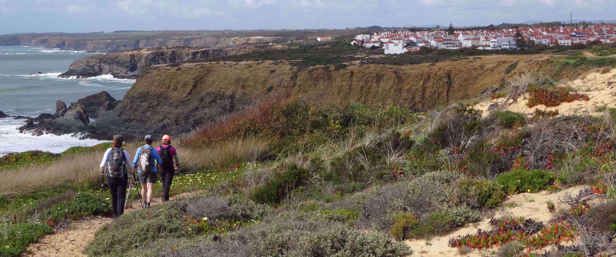 three women hiking along portugal coast