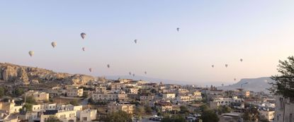 Hot air balloons floating over cappadocia