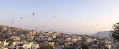 Hot air balloons floating over cappadocia