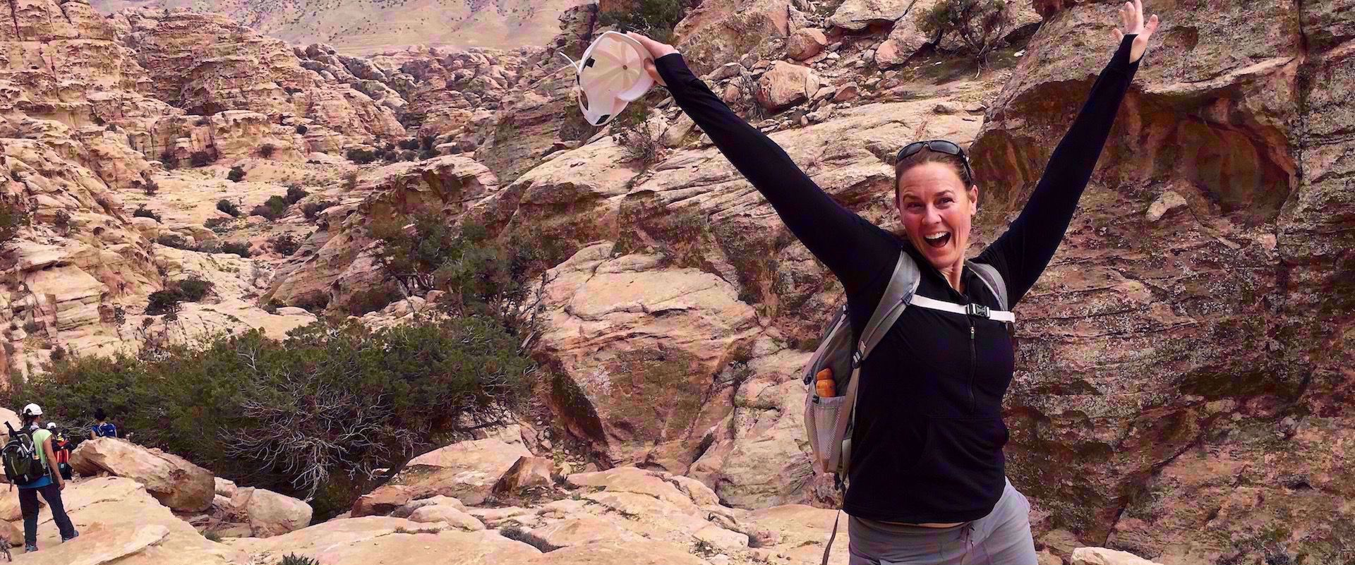 woman smiling on group travel adventure through jordan