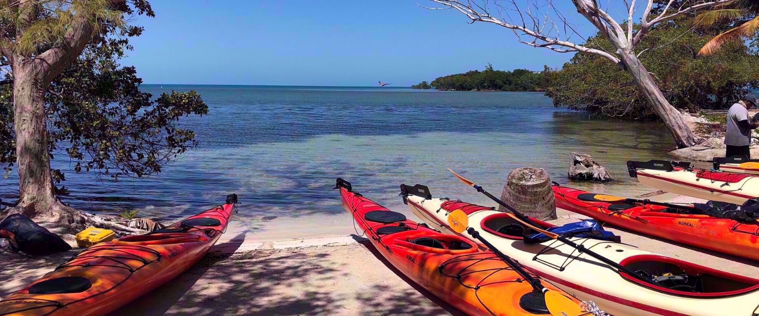kayaks on beach in Belize