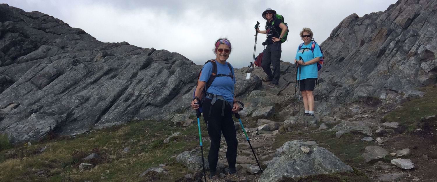 women hiking down mountains in VA
