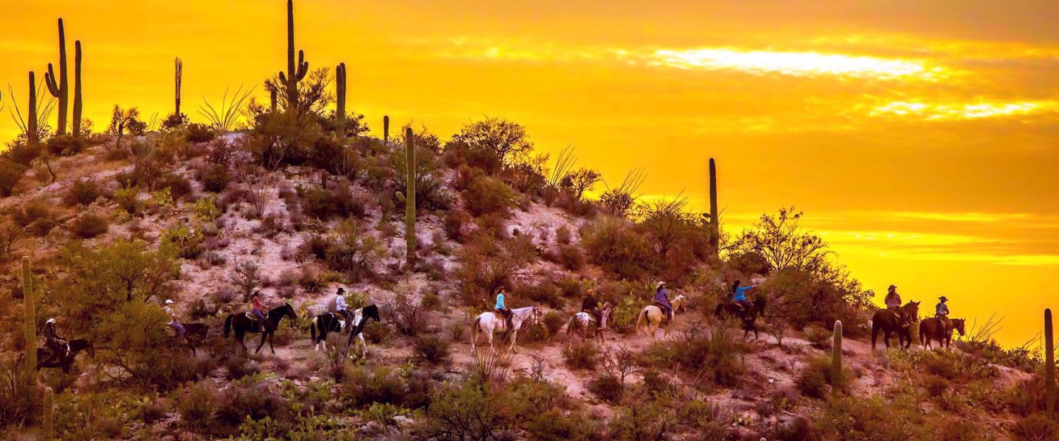 sunset horseback ride in desert around Tanque Verde Ranch